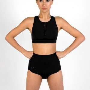 Scoop zip front sports crop bikini top made with Yulex + High waisted sustainable surf shorts - front view in studio
