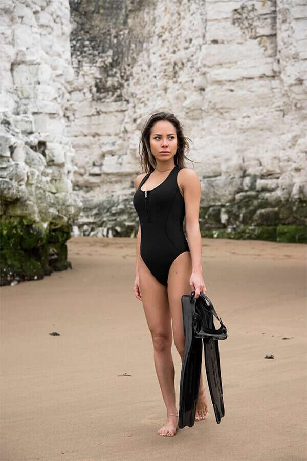 One Piece Swimsuit - zip front racerback made with sustainable fabric yulex - SLO active (lifestyle on beach)
