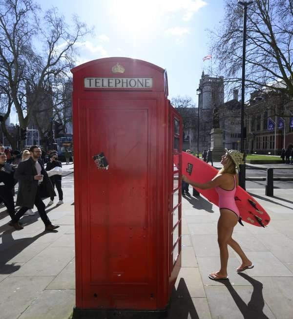 Alison In London Wearing SLO active One Piece in PINK