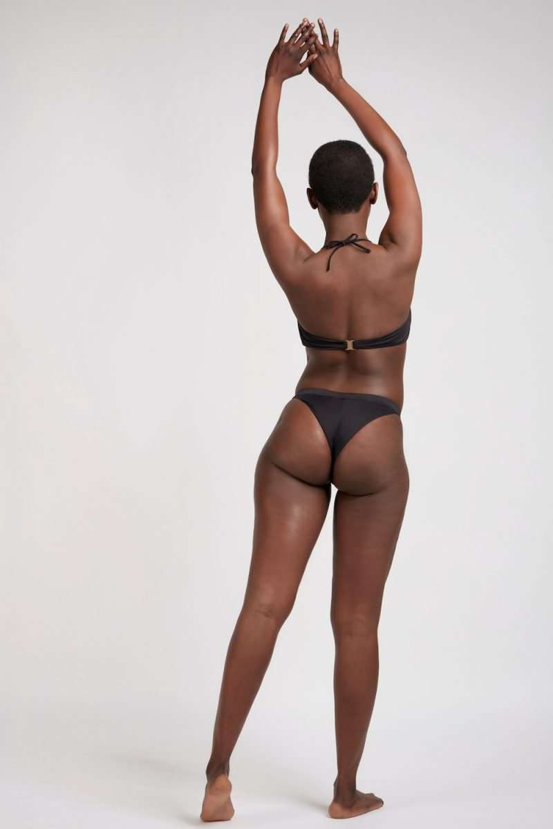 Sustainable cheeky thong bikini bottom and bandeau top (behind) in black for surfing and yoga BLACK - sustainable swimwear